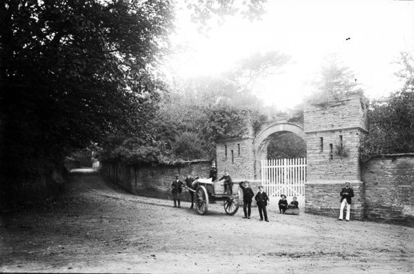 Gatehouse to Prideaux Place at corner on Tregirls Lane, with horse and cart. Photographer: Unknown