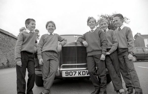 Off to Fowey School in style aboard a Rolls Royce are these five pupils from Lostwithiel. At an auction of promises at the Community Centre their parents bought a pledge from David Williams of the Crown Inn to take a group of children in his 'Roller'