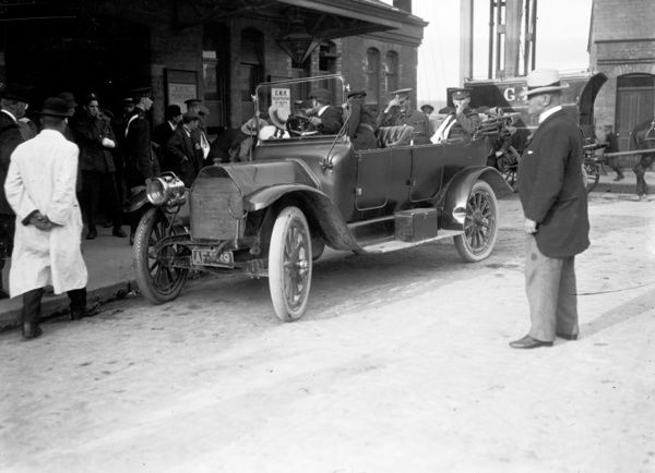 Wounded soldiers in open car outside Truro Railway Station en route to the Royal Cornwall Infirmary as the first batch of patients, June 16, 1915. Photographer: A.W. Jordan