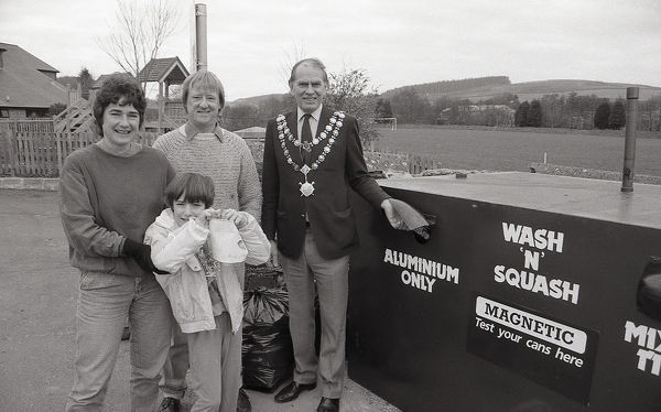 The first can recycling bank in Lostwithiel is opened by the Mayor Dennis Hutchings, along with Richard Bower MBE and Marian Chanter, environmentalist, with her daughter, Emily