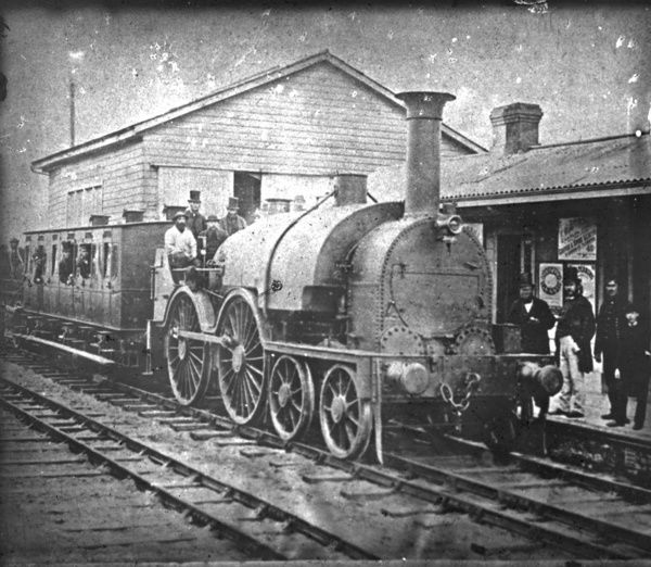 This well known photograph depicts the first broad gauge passenger train to arrive at Redruth from the west on 1st March 1867. It also shows that the station has been extended towards the goods shed, revealed by the change in chimney brickwork colour