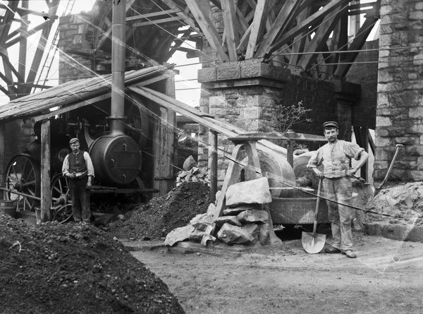 Two workmen using a stationary steam engine with a belt drive, building the new stone piers to replace Brunel's original stone piers topped with wooden fanned supports. The new viaduct opened on the 17 August 1902. Photographer: Unknown