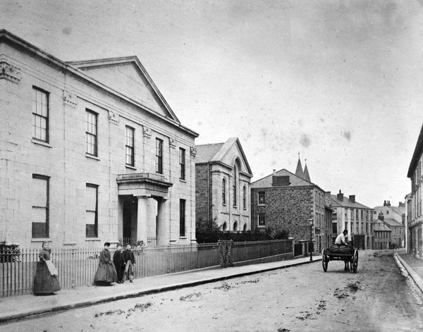 A view of River Street, looking east, showing the Truro Savings Bank and Baptist Chapel, later to become the Royal Cornwall Museum. Recorded in 1852-1853 at 27 River Street, was the premises of J. Hugo, a dyer. The business had moved to Kenwyn Street by 1878