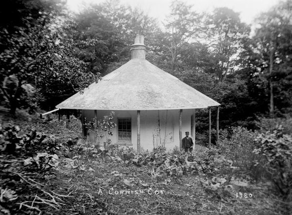 A man stands outside the round house. Photographer: Arthur William Jordan