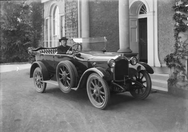 A Rover 12 motor car circa 1922 (registration number AF 4061) presented by the diocese to the Bishop of Truro who is sitting behind the wheel outside 'Lys Escop' the Bishops palace