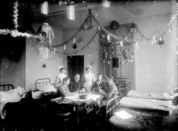 Nurses and patients (one a sailor) playing cards in the ward at the Royal Infirmary. Photographer: Arthur William Jordan