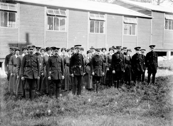 X Ward. Nurses and military personnel lined up outside ward. Photographer: A.W. Jordan