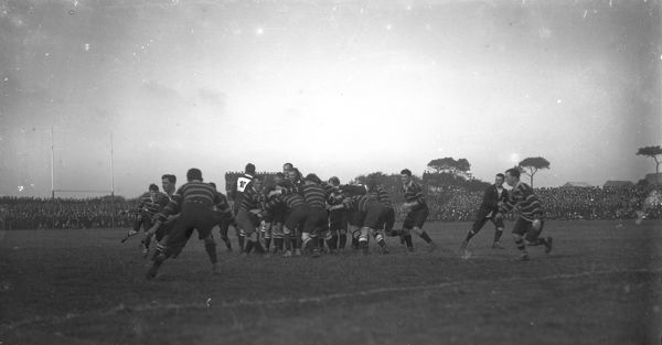 A match between Cornwall, in the striped jerseys, and the touring South African Springboks team at Redruth. The picture shows a scrum during the match. The Springboks went on to win the match 15-6. Photographer: Unknown
