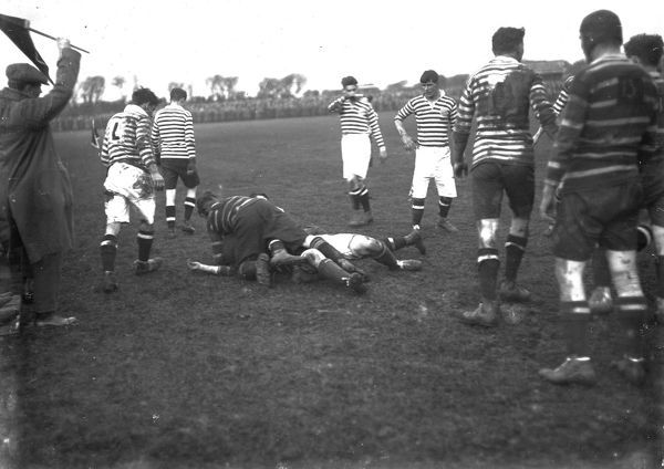 A match between Cornwall, in the broad stripes, and an unknown team thought to be about 1919. A melee is breaking up. Photographer: Arthur William Jordan