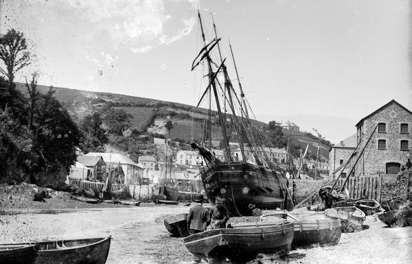 A topsail schooner and other boats at low water at the seaward end of East Looe quay. Photographer: Surgeon Captain John Campbell