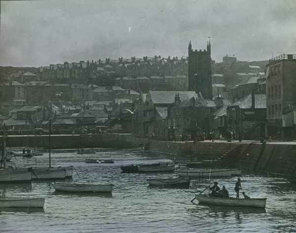 Back of harbour and church. Glass lantern slide from a lecture, entitled 'Some Historic Cornish Beauty Spots', given by Cornishman and amateur photographer, Major Gill, in around 1925. He was well known in Cornwall and elsewhere during the 1920s