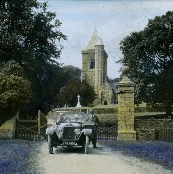 Major Gill's car in the foreground. St Michael Penkivel church contains four altars, one of which is in the tower. Glass lantern slide from a lecture, entitled 'Some Historic Cornish Beauty Spots', given by Cornishman and amateur photographer