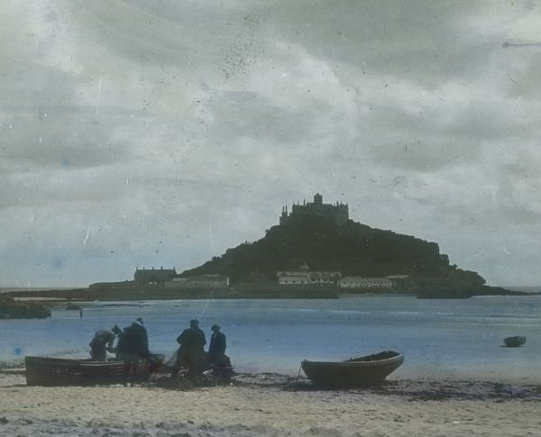 Taken from Marazion beach with fishermen and boats on foreshore. Glass lantern slide from a lecture, entitled 'Some Historic Cornish Beauty Spots', given by Cornishman and amateur photographer, Major Gill, in around 1925. He was well known in Cornwall