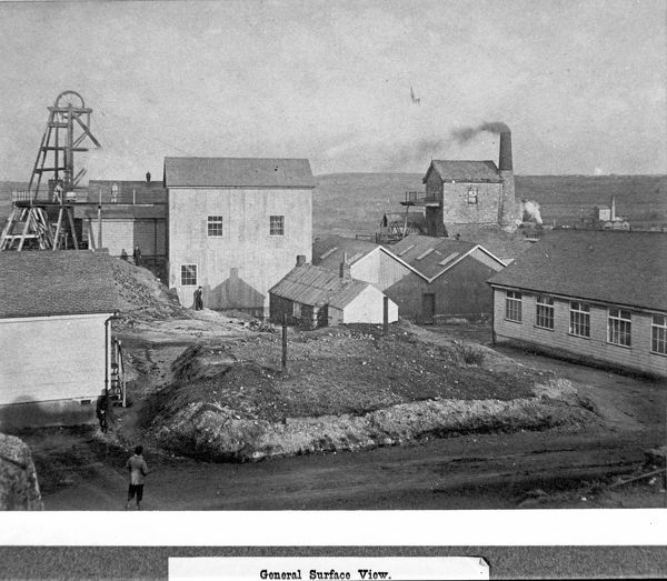Surface view showing headgear and working engine house. In 1897 part of the property was transferred to Camborne School of Mines as the (later) King Edward VII mine. Photographer J. C. Burrow