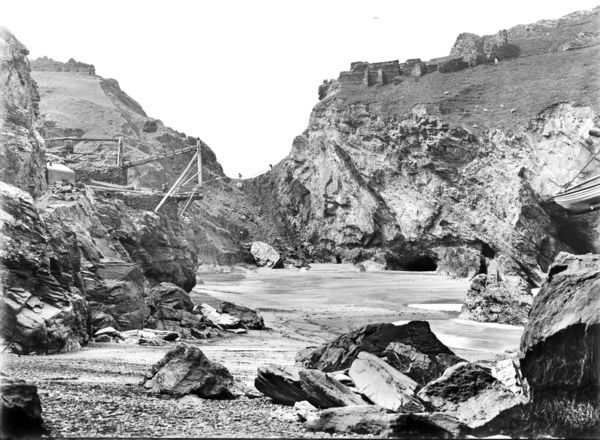 Tintagel Castle in isthmus from beach below hotel, winze (connecting frame for underground mine) on left. Photographer: John Charles Burrow