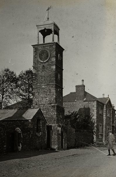 The clock tower was built in the 1830s, along with the two, single-storey, market houses on either side of it. Glass lantern slide from a lecture, entitled 'Some Historic Cornish Beauty Spots', given by Cornishman and amateur photographer