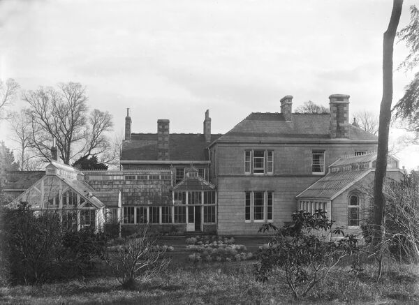 The side and rear of Treliske House with glasshouses. This was formerly the home of W. Teague and later became Truro School. Photographer: Arthur William Jordan