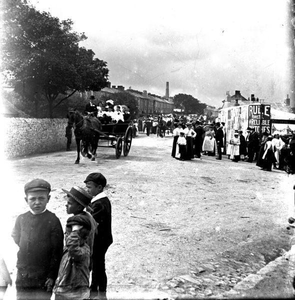 Procession with children in open waggon, possibly Tea Treat or Bank Holiday