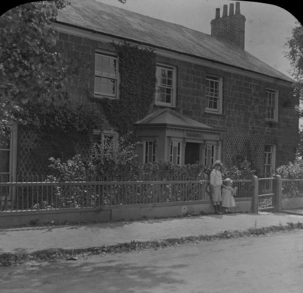 Two children standing outside the vicarage. Photographer : Ennor