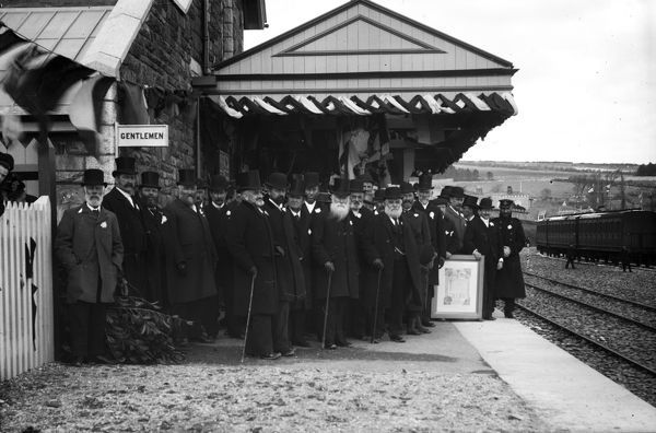 A crowd wait to welcome the first train into Padstow railway station. The station was the western terminus of the North Cornwall Railway and was operated by the London and South Western Railway. Photographer: Unknown