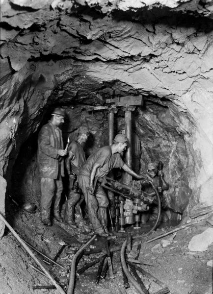 A team of miners drilling underground at 320 fathom January 1895.Believed to be photographed by J.C. Burrow