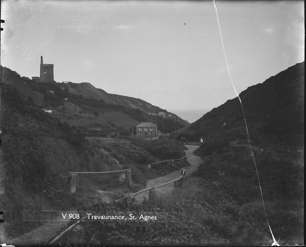 View down the valley from Trevaunance towards the engine house. Children are walking along the road. Photographer: Arthur William Jordan