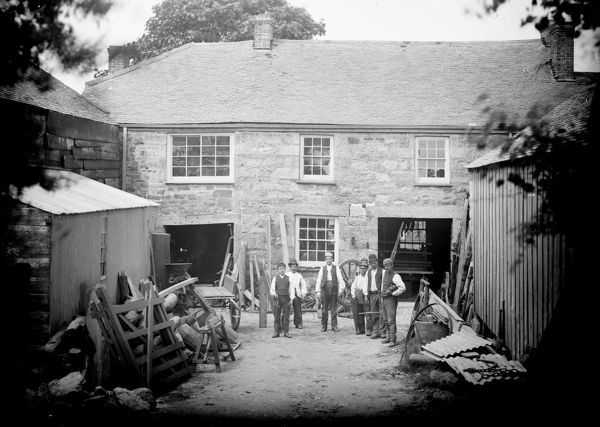A wheelwright or wagon-maker shop in the late 19th century. Thomas Faull was a wheelwright in the Wendron Churchtown in 1873, and at Trenear from 1883. Photographer: Samuel John Govier