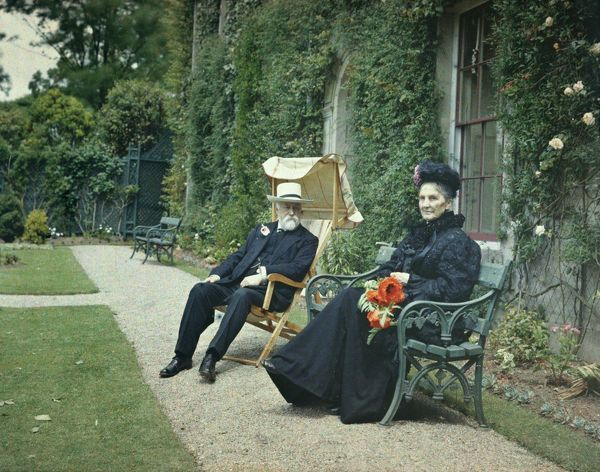 Portrait of Major Arthur William Gill's parents, William Nicholas Gill and Ada Gill (nee Branwell), sitting in the garden at the front of Comprigney House