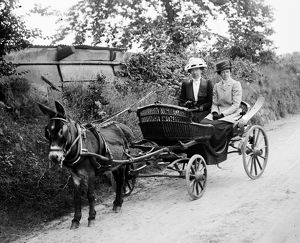 Donkey cart with two women, Cornwall. 1910