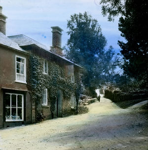 The Falcon Inn and view up hill with a postman walking towards the camera. St Mawgan in Pydar
