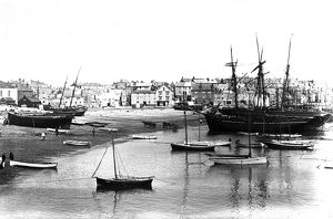 Fishing boats and schooners beached in St Ives harbour, Cornwall. Early 1900s