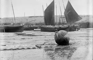 Fishing craft off Smeaton's Pier at low tide. St Ives Harbour, Cornwall. Before 1900