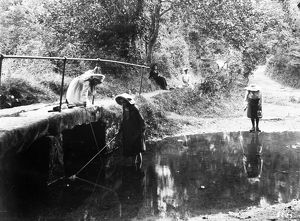 Three girls fishing in the River Kenwyn at the ford and footbridge, Treliske Lane