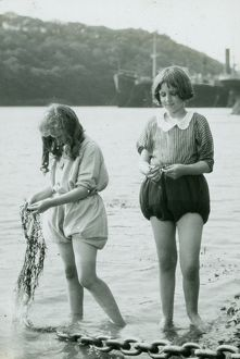 King Harry Ferry, Feock, Cornwall. Two girls paddling