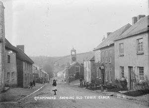 Grampound showing old town clock, Fore Street, Grampound, Cornwall. Early 1900s