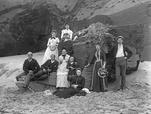 Group of people posed below cliff at Padstow, Cornwall. Probably 1890s or early 1900s