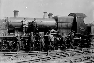 GWR (4-4-0) Bulldog SWIFT (3350) with men posed in front. Between 1900 & 1912