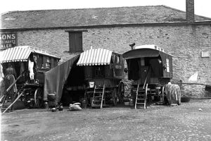 Gypsy caravans parked behind a merchants premises, Truro, Cornwall. 1900s