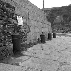 Harbour wall with cannon bollards, Polkerris, Tywardreath, Cornwall. 1976