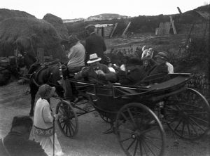 Horse drawn carriage with passengers, Cornwall. Possibly 1920s