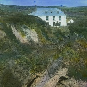 House above the cliff at the back of Bessie's Cove, Prussia Cove, Cornwall