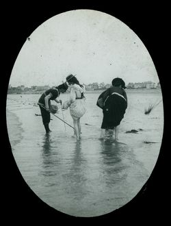 Ladies paddling on an unknown beach, Cornwall. Around 1925