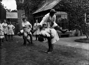 Members of the First World War Women's Land Army playing leap frog. Tregavethan Farm