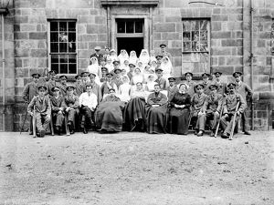 Patients and nurses outside the Royal Cornwall Infirmary, Truro, Cornwall. Probably 1916