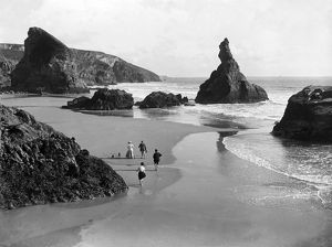 People on the beach at Bedruthan Steps, St Eval, Cornwall. Around 1900
