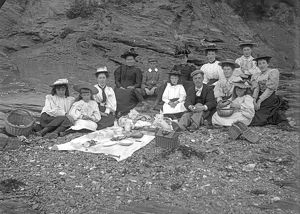 A picnic party below cliff, Padstow, Cornwall. Probably 1890s or early 1900s