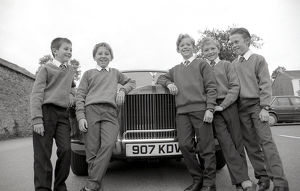 Pupils travel to school in a Rolls Royce, Lostwithiel, Cornwall. September 1989