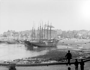 Three schooners beached in the harbour at low tide, St Ives, Cornwall. Early 1900s