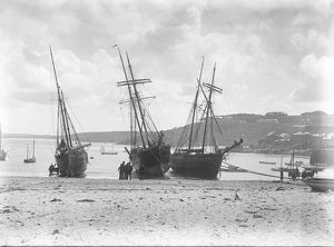 Three schooners beached in St Ives Harbour, Cornwall. Early 1900s