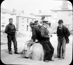 Seamen chat on the quayside, Flushing, Cornwall. 1890s